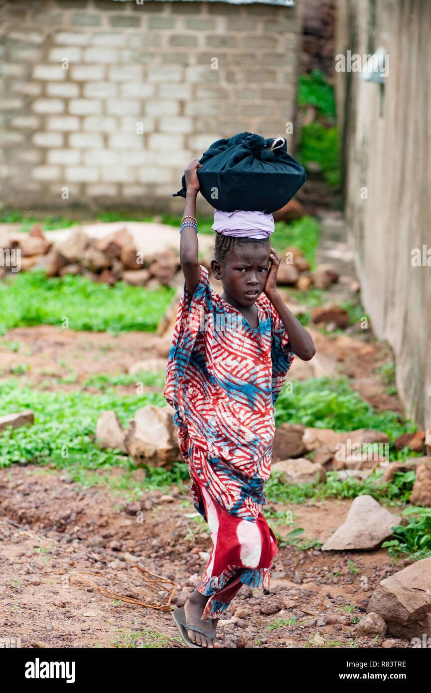 Mali Africa Black Young Girl Carrying Food On Her Head Bamako Town Urban Scene Stock Photo Alamy