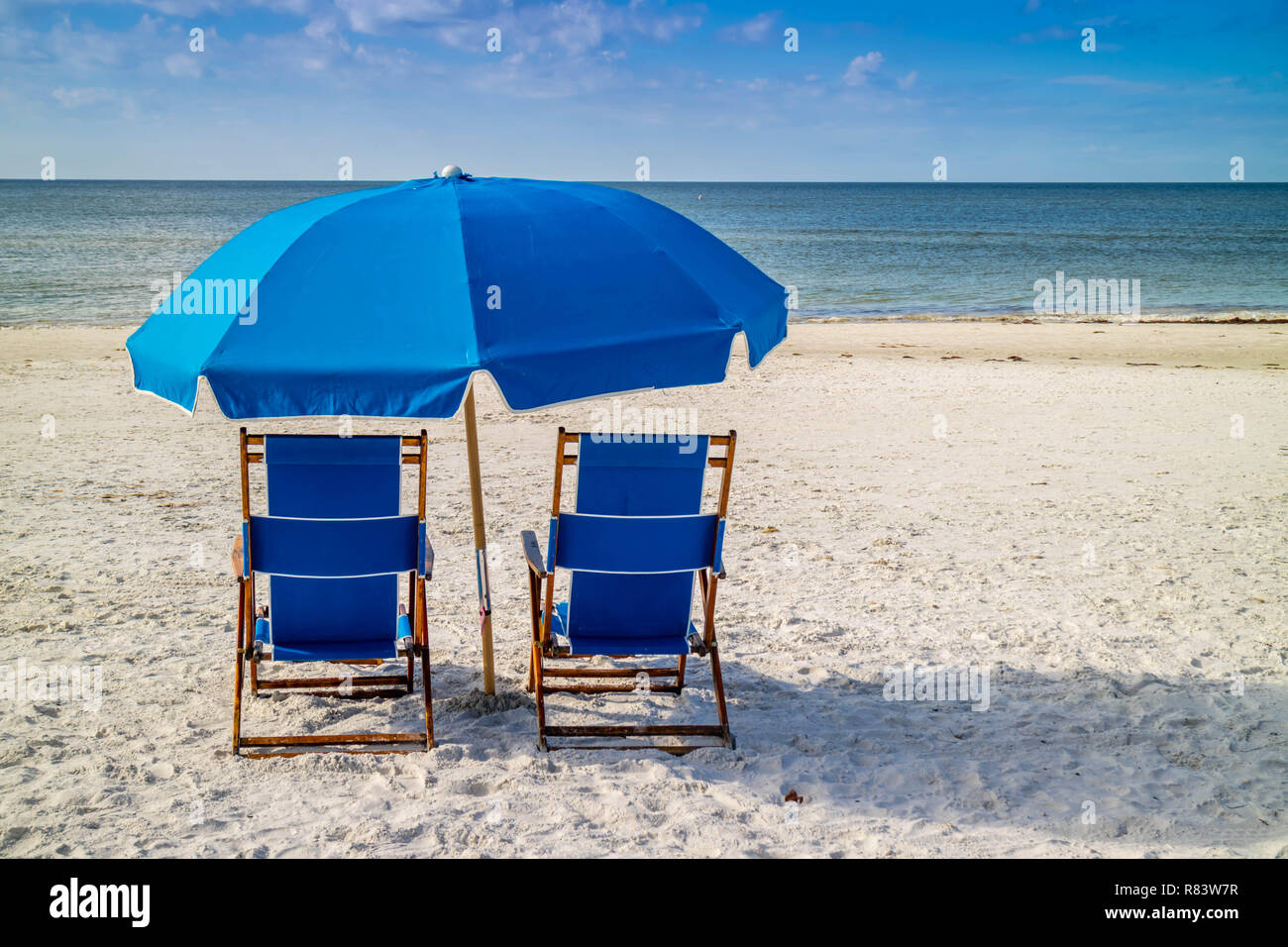 A beach Chaise Longue fronting the beach in Fort Myers, Florida - Stock Image