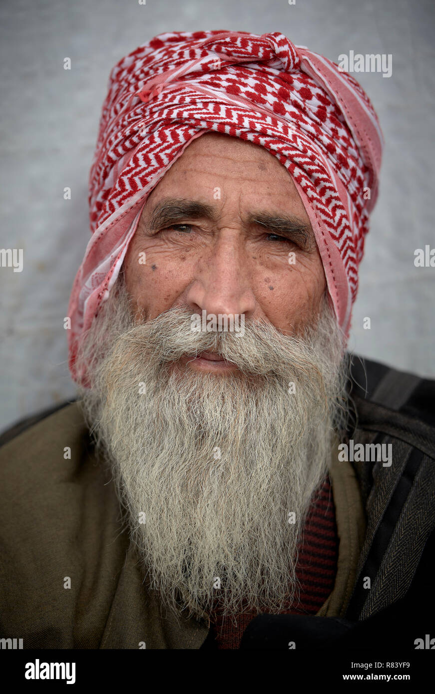 A Yazidi man in a camp for internally displaced persons at Dawodiya in Iraq's Kurdistan region. Over 600 Yazidi families live in the camp. - Stock Image