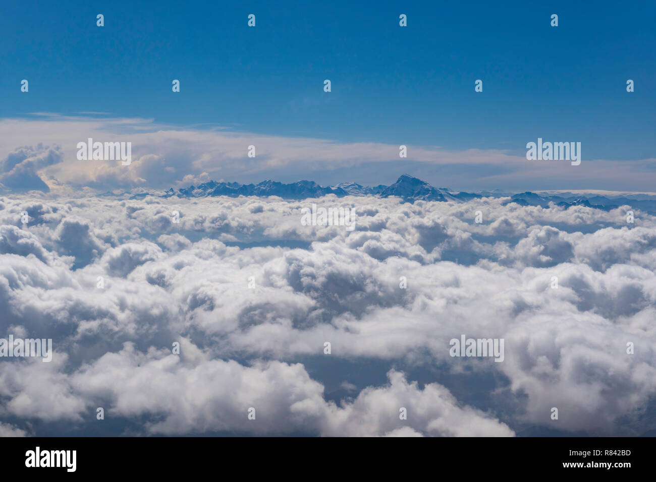 Mountain peaks above clouds - Stock Image