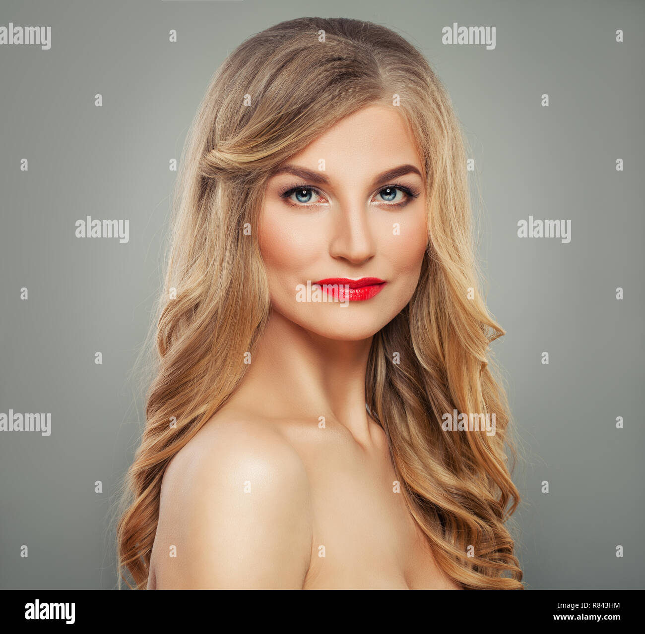 Blondie woman with long blonde hair and red lips makeup, fashion portrait