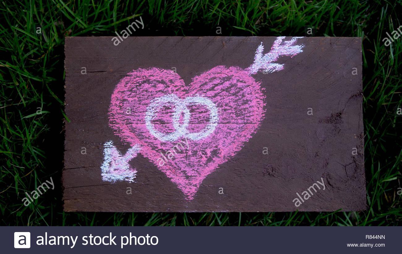 wedding heart chalk drawing wooden shield decoration - Stock Image