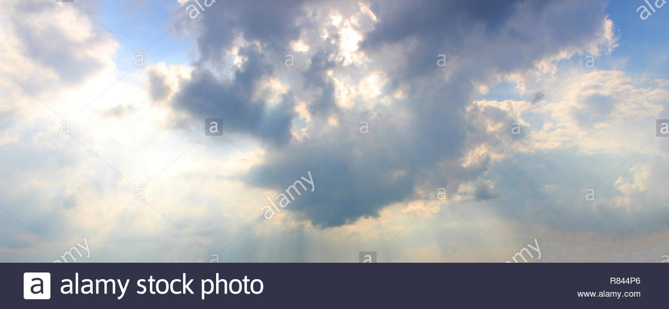 cloud background blue with sunbeams - Stock Image