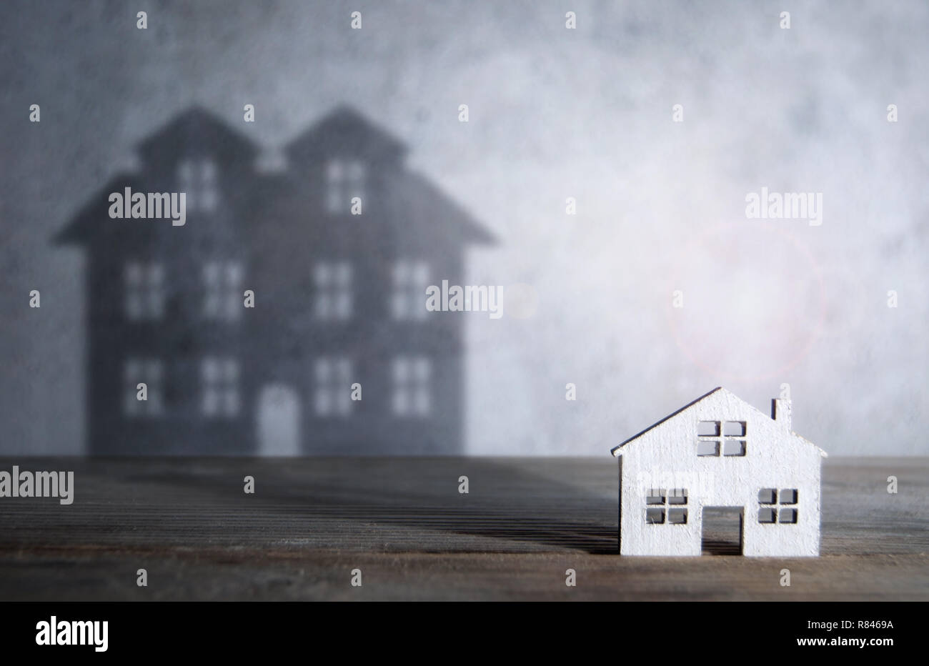 Shadow of a large house from a miniature home Stock Photo