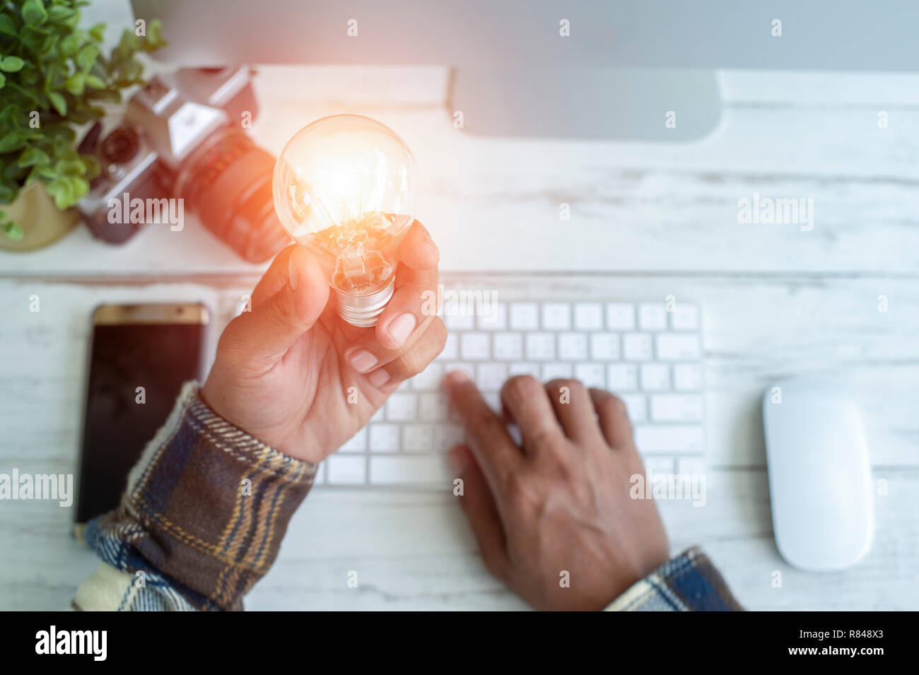 Mobile bulbs with innovative ideas and creativity. - Stock Image