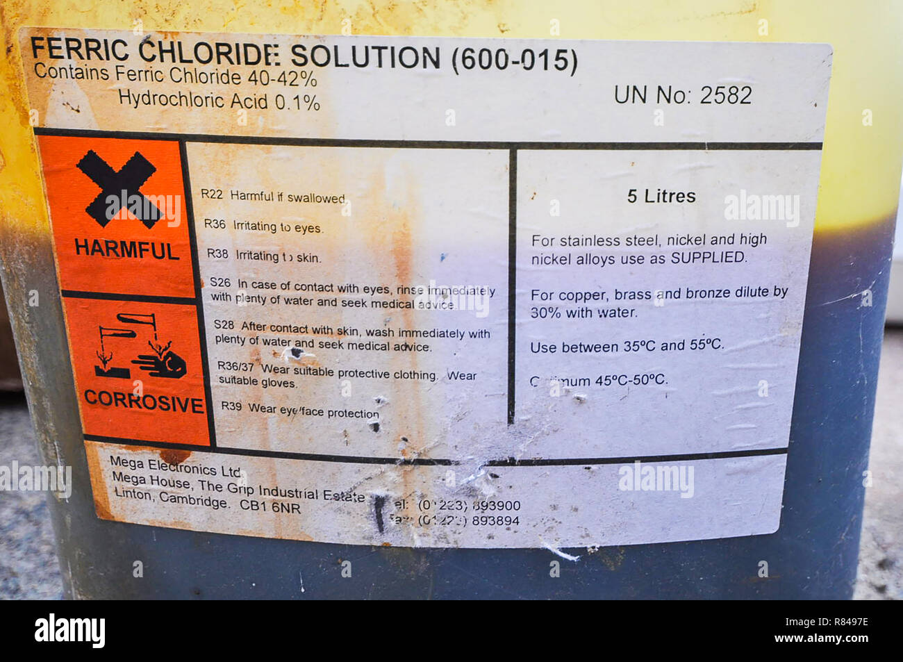 Ferric Chloride Solution container, looking rough. Chemicals. Iron(III) chloride harmful corrosive chemical. FeCI3. Etchant etching chemical for pcb - Stock Image