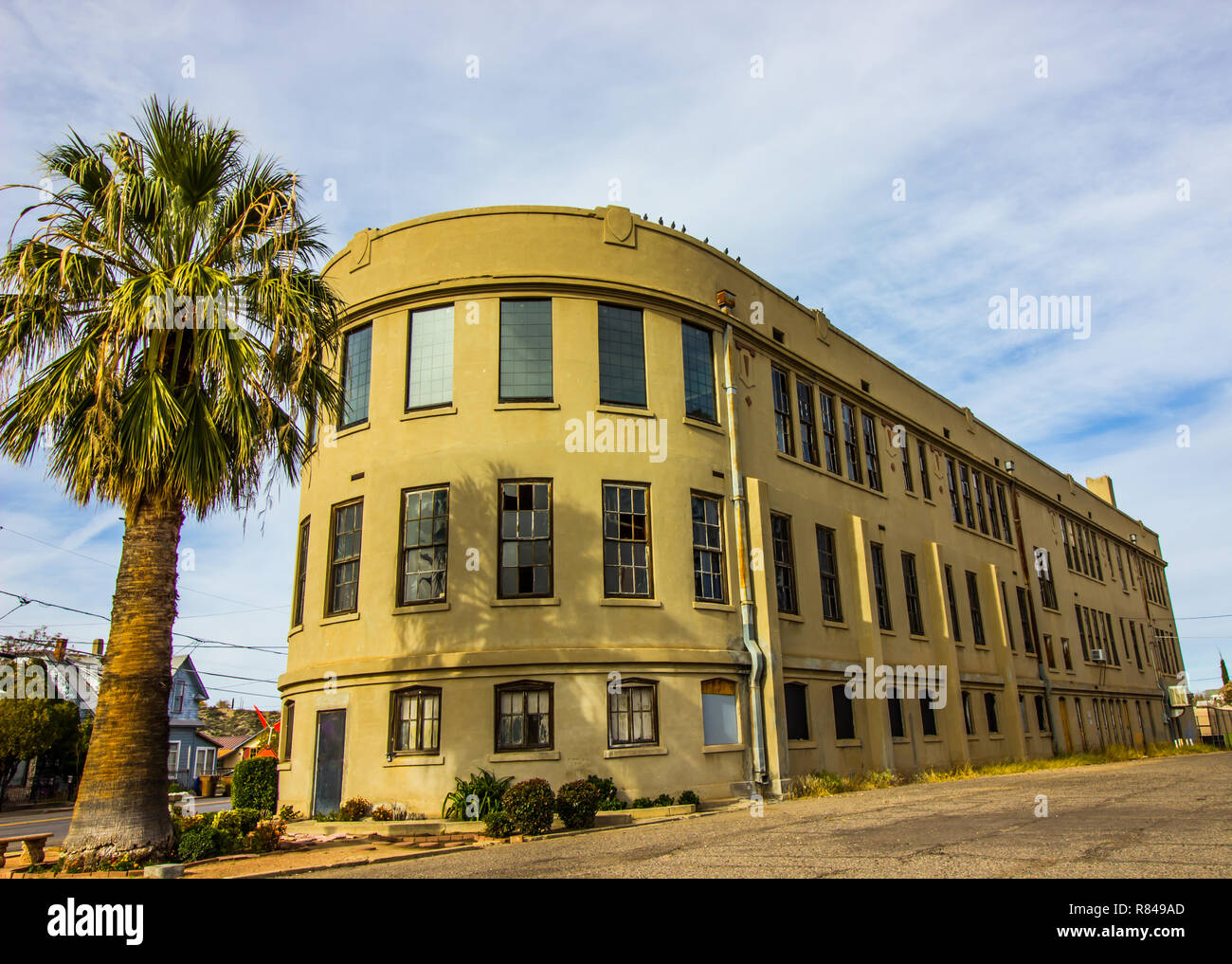 Abandoned Retro Three Story Building With Rounded Front - Stock Image