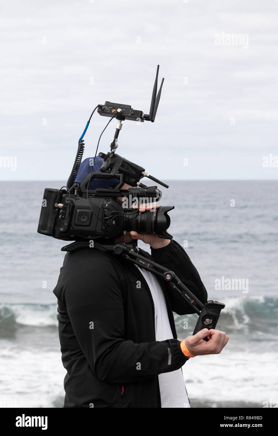 Video camera with wifi router streaming live coverage of surfing event. - Stock Image