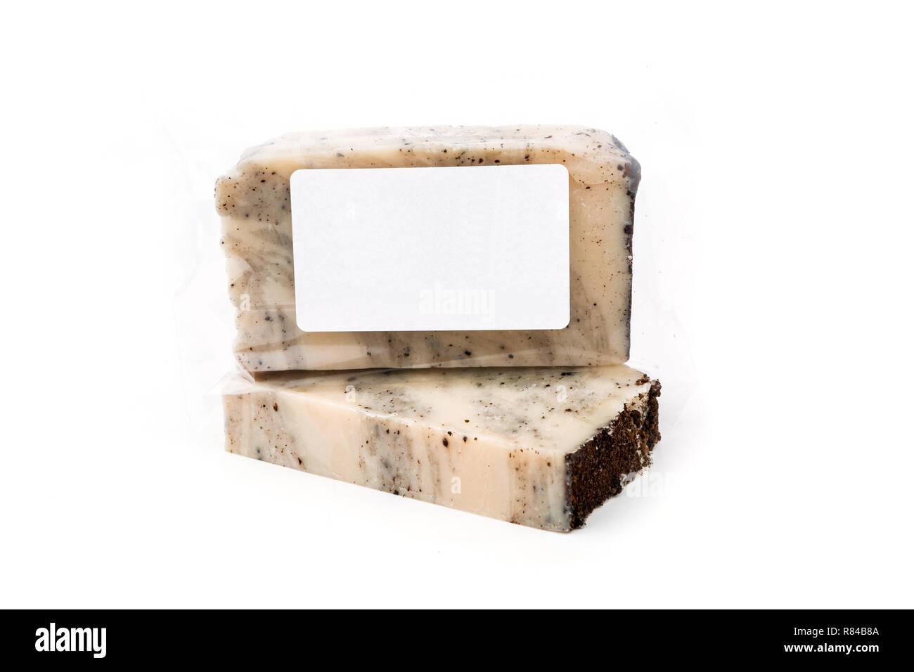 Handmade artisan coconut soap bars on white background - Stock Image