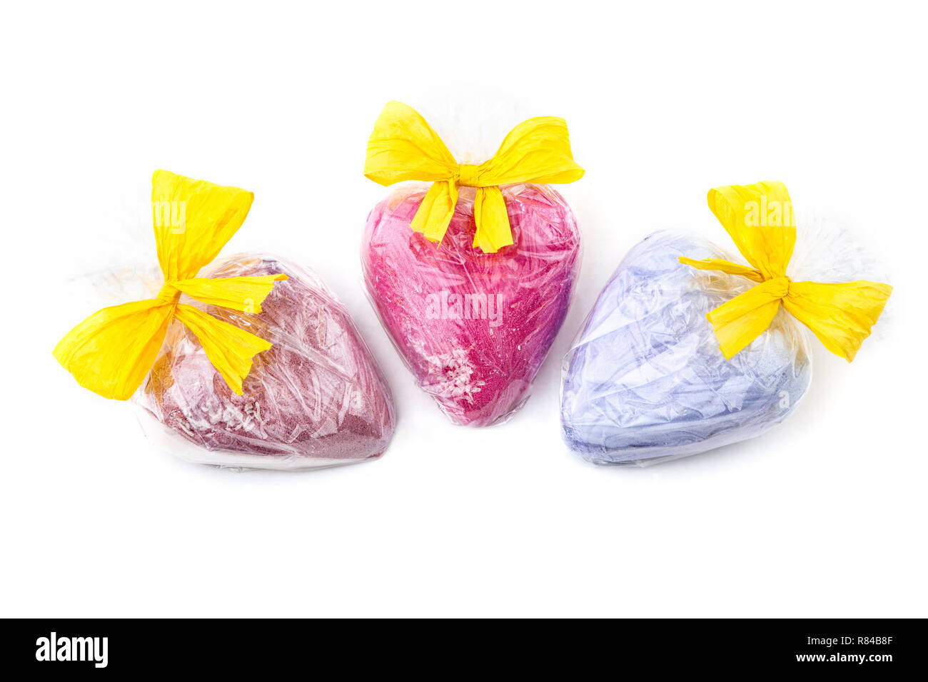 Heart shaped bath bombs gift wrapped on white background - Stock Image