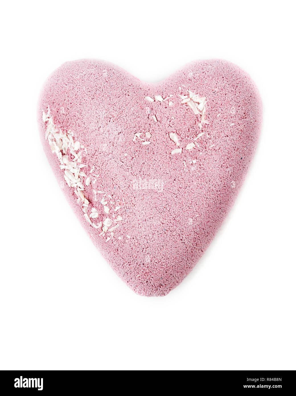Heart shaped bath bomb on the white background - Stock Image