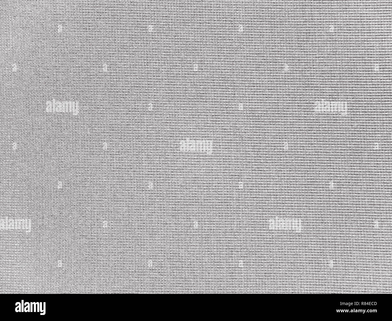 Medium gray polyester activewear fabric texture swatch. Synthetic material. - Stock Image