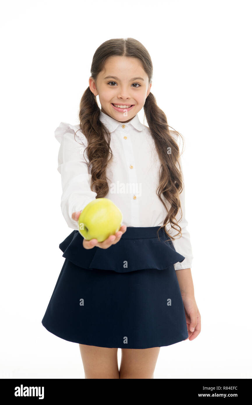f6e967ef8671 Girl cute pupil hold apple fruit stand on white background. Kid happy hold  apple. School snack concept. Healthy nutrition diet. Apple vitamin snack.