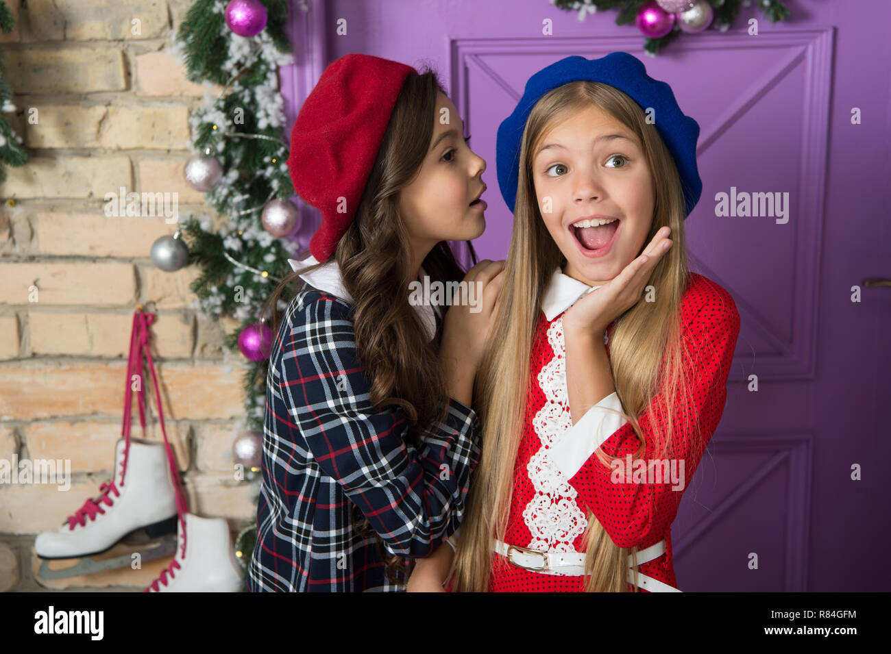 Winter gossips concept. Girls small kids front festive christmas decorations. Lets have fun and celebrate christmas. Christmas tips for kids. Children cute girls ready meet christmas and new year. - Stock Image