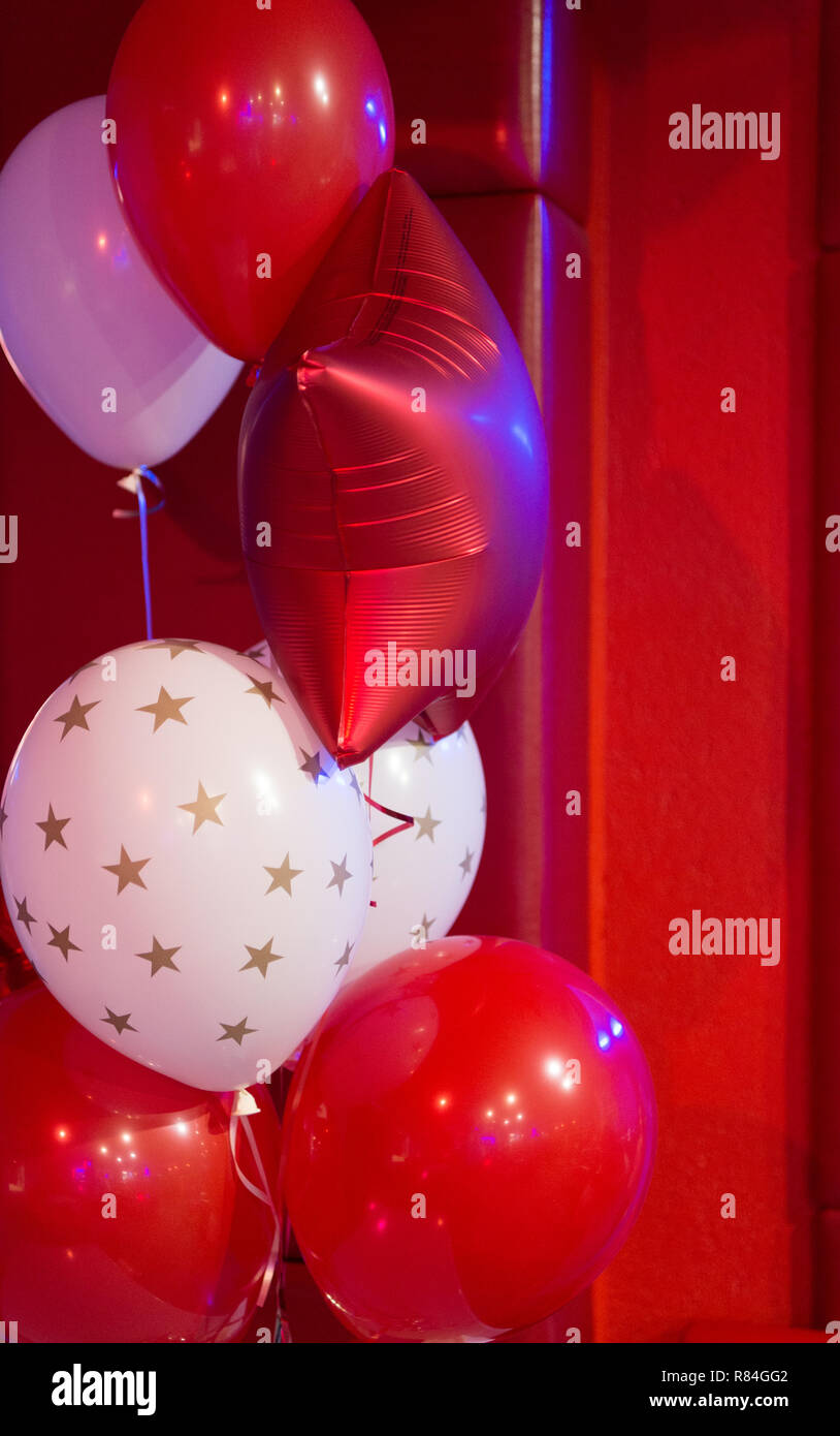 Red and white balloons with stars pattern. Balloon traditional holiday attribute. Every party needs balloons. Happy birthday concept. Celebrate birthday holiday with festive colorful air balloons. - Stock Image