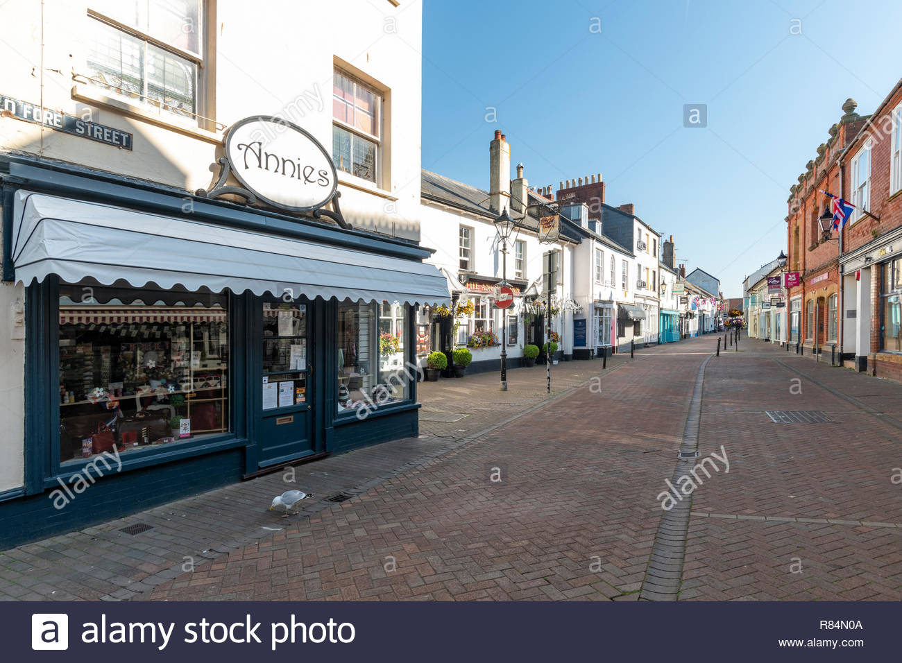 Shops in Old Fore Street, Pedestrianised street scene Sidmouth, Devon, England, Britain, UK - Stock Image