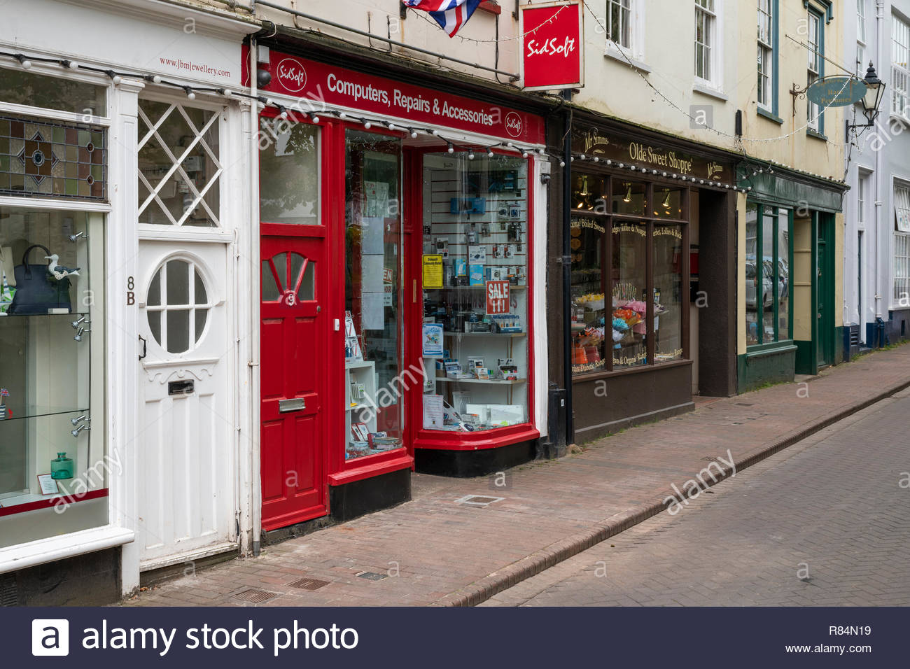 Shops in Church Street, Sidmouth, Devon, England, Britain, UK - Stock Image