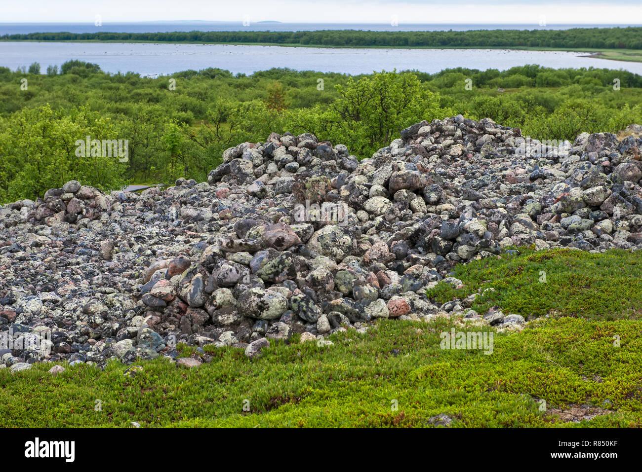 Stone mounds - artificial stone mounds of small boulders on the Bolshoy Zayatsky Island. Solovetsky archipelago, White sea, Russia - Stock Image
