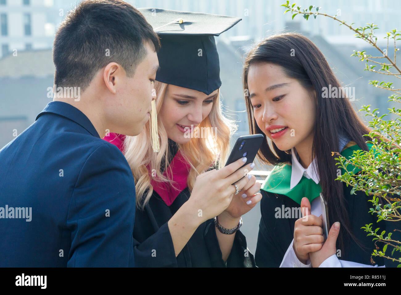 International students celebrating graduation - Stock Image