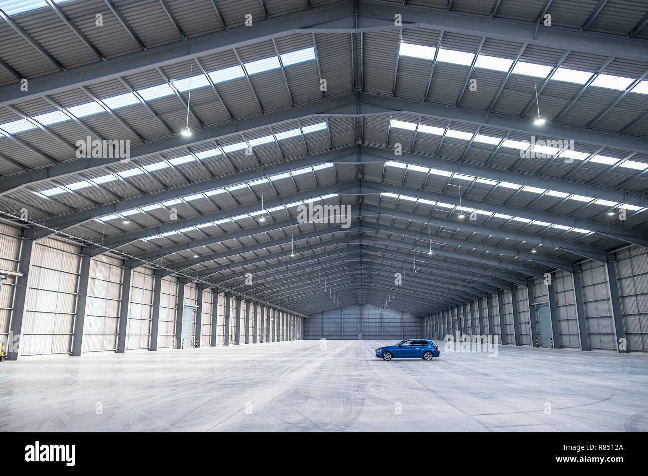 enormous empty warehouse space - Stock Image