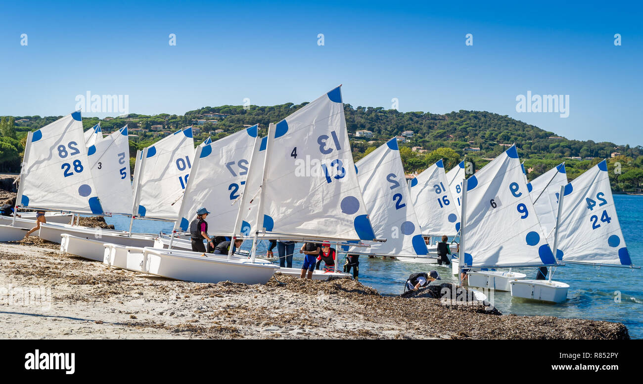 Optimist sailing boats at the beach of Saint-Tropez - Stock Image