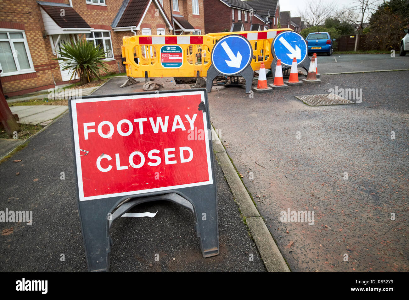 footway footpath closed for emergency utility repairs on a housing estate in merseyside england uk - Stock Image