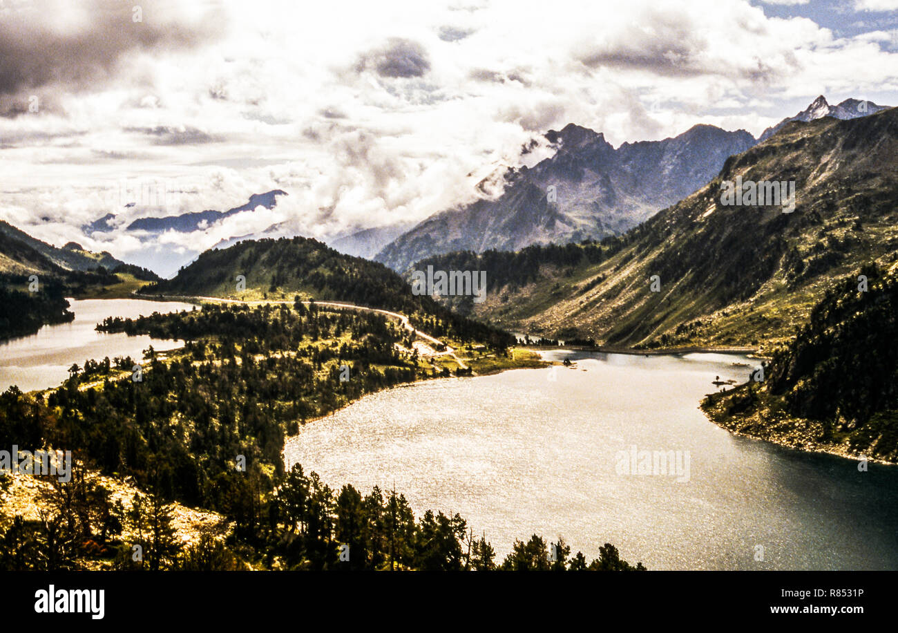 The Pyrenees Nat.Park of Neouvielle .Pic Ramon on left.Pic de Neouvielle on  the right.Lake of Aubert (right),Lake Aumar on left. - Stock Image