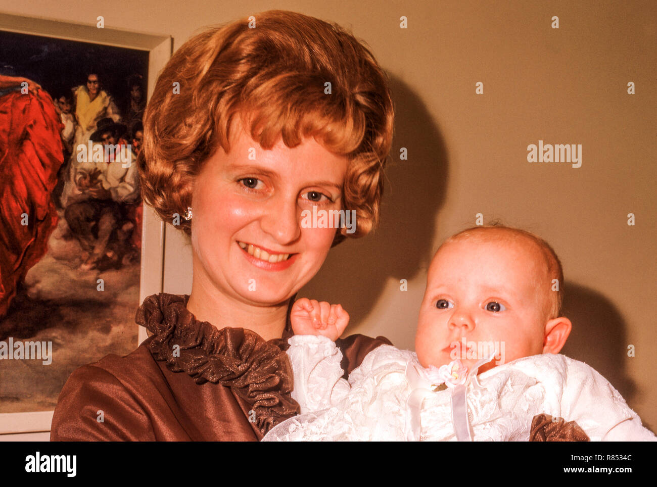 Mother and daughter on Christening Day - Stock Image