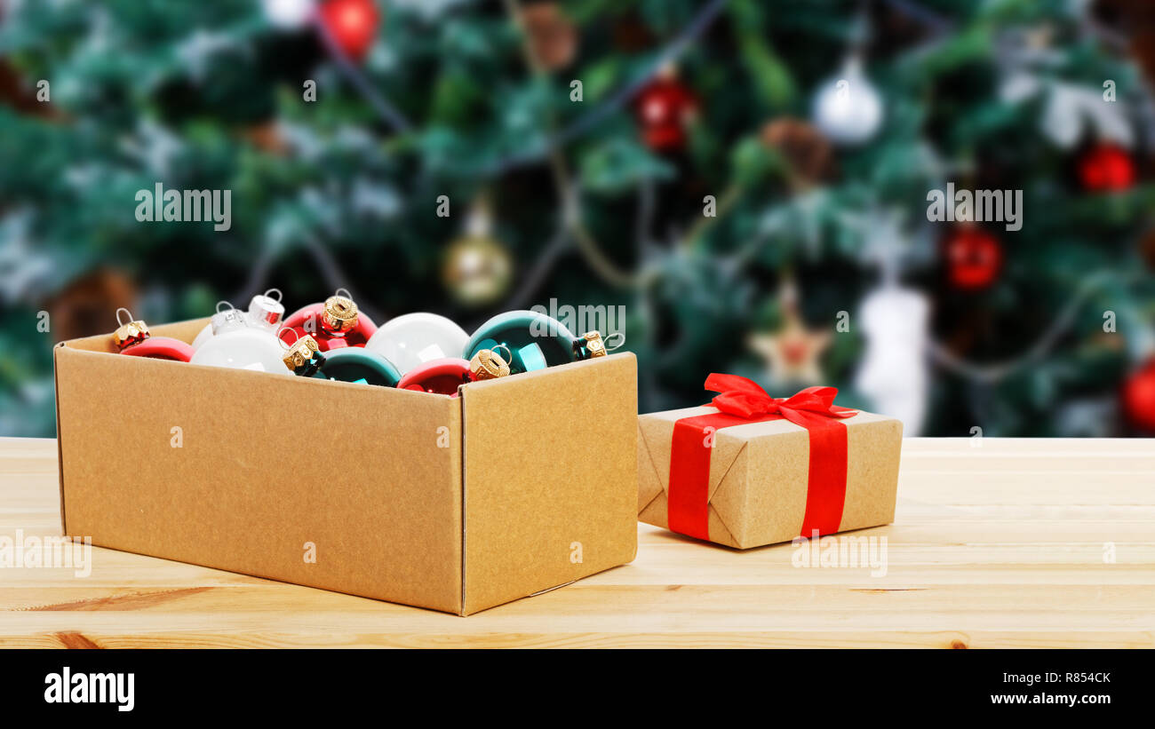 Cardboard Box With Colorful Glass Christmas Balls And Gift Wrapping