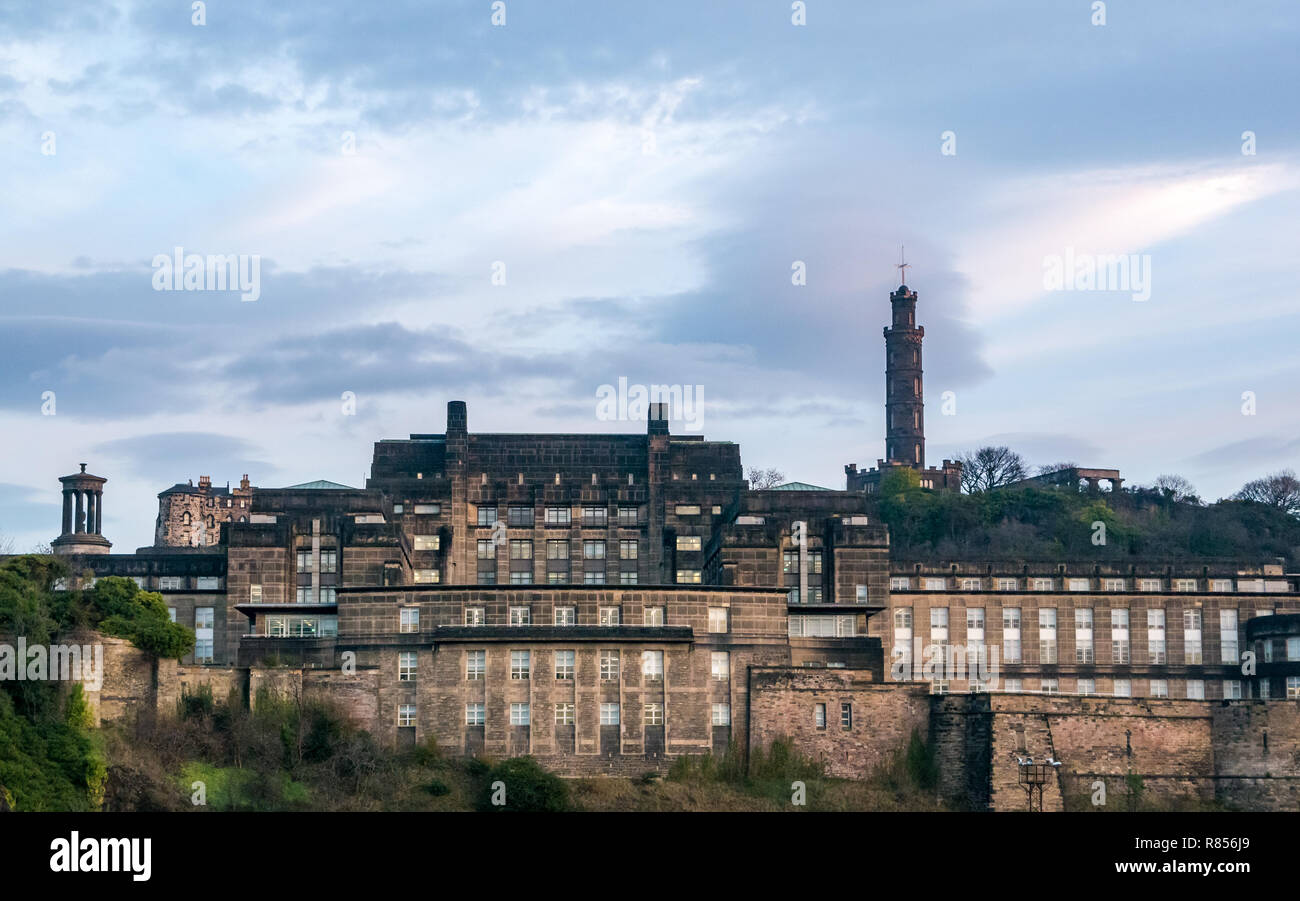 Edinburgh grand buildings in Winter dawn. St Andrews House, Scottish Government headquarters, and Calton Hill monuments, Scotland, UK Stock Photo