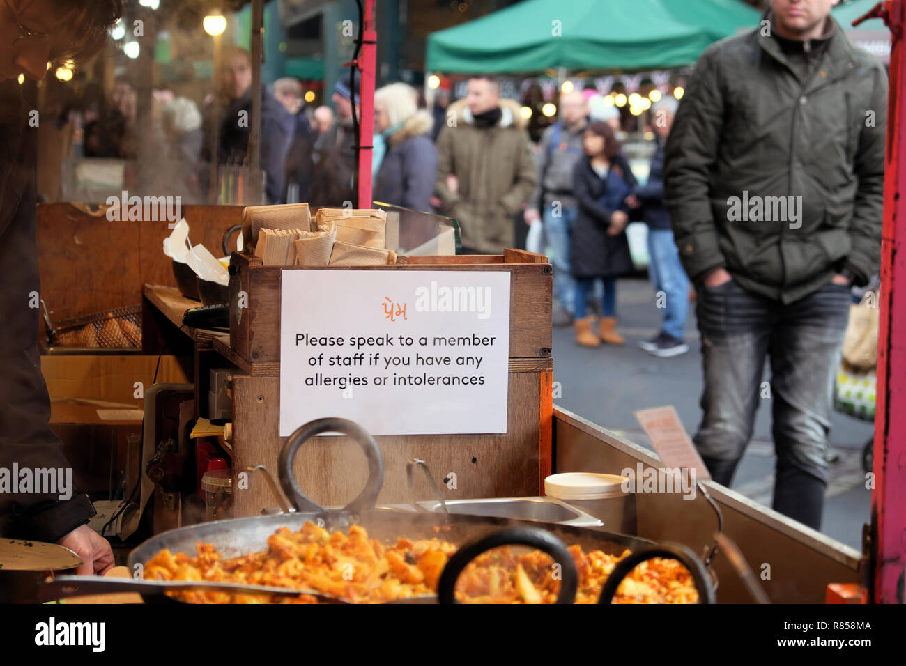 Allergy and food intolerance notice sign on a stall at Borough Market Christmas food in London England UK  KATHY DEWITT Stock Photo