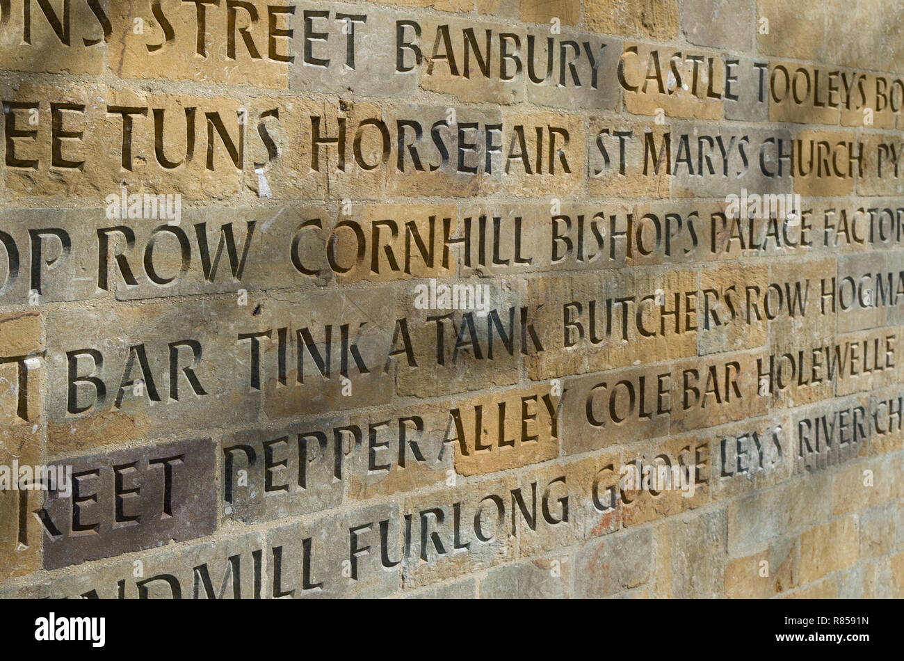 Carved inscriptions on the exterior wall of refurbished public conveniences, Banbury, UK;  listing the various streets within the town. - Stock Image