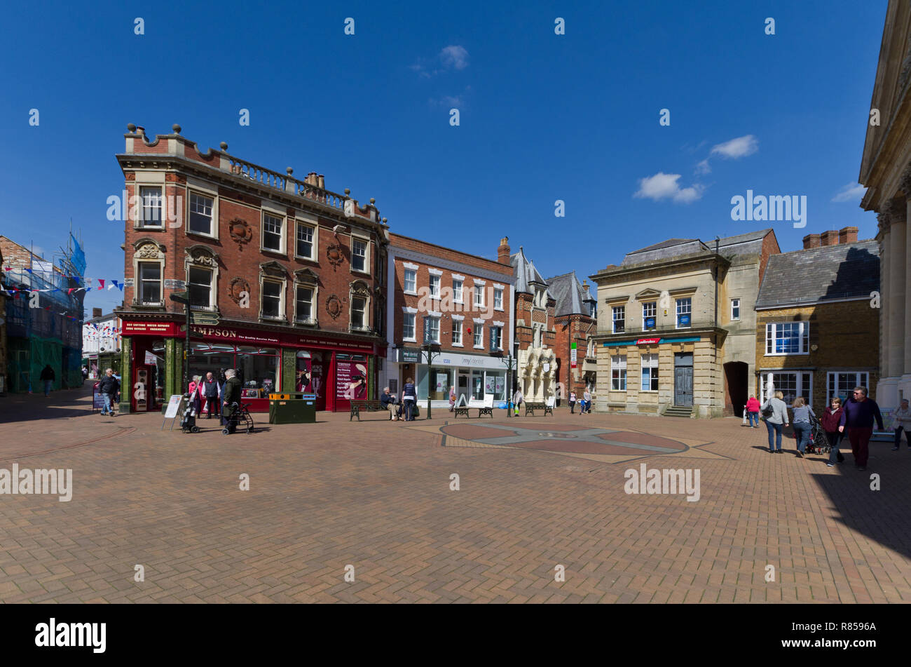 Pedestrianised Market Place area of Banbury, Oxfordshire, UK; with premises occupied by Timpsons, My Dentist and Ladbrokes. - Stock Image