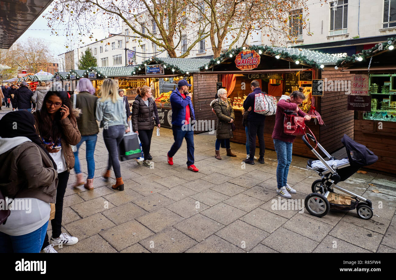 Busy Xmas shopping scene with Christmas market stalls in Commercial Road, Portsmouth, England - Stock Image