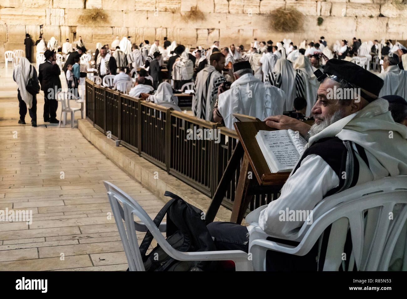 Religious orthodox jew praying at the Western wall and reads the Torah in Jerusalem old city. JERUSALEM, ISRAEL. 24 October 2018. - Stock Image