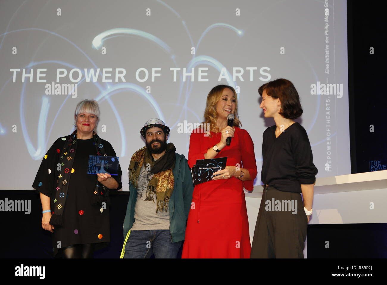 Berlin, Germany. 12th Dec 2018. The winners Migrantpolitan (Hamburg) and Petra Gute (second from right). On the 12th of December the solemn award ceremony of the initiative 'The Power of the Arts' takes place for the second time in Berlin. With 200,000 euros it is the highest endowed prize for cultural participation in Germany.  Migrantpolitan on Kampnagel and the literary portal Weiter Schreiben. Credit: SAO Struck/Alamy Live News - Stock Image