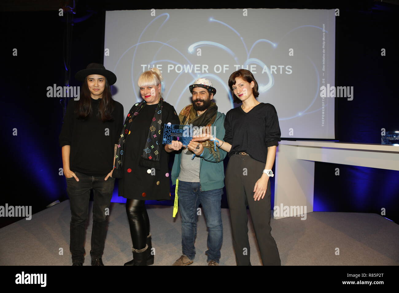 Berlin, Germany. 12th Dec 2018. Diana Kinnert (left) and the winners Migrantpolitan (Hamburg). On the 12th of December the solemn award ceremony of the initiative 'The Power of the Arts' takes place for the second time in Berlin. With 200,000 euros it is the highest endowed prize for cultural participation in Germany.  Migrantpolitan on Kampnagel and the literary portal Weiter Schreiben. Credit: SAO Struck/Alamy Live News - Stock Image