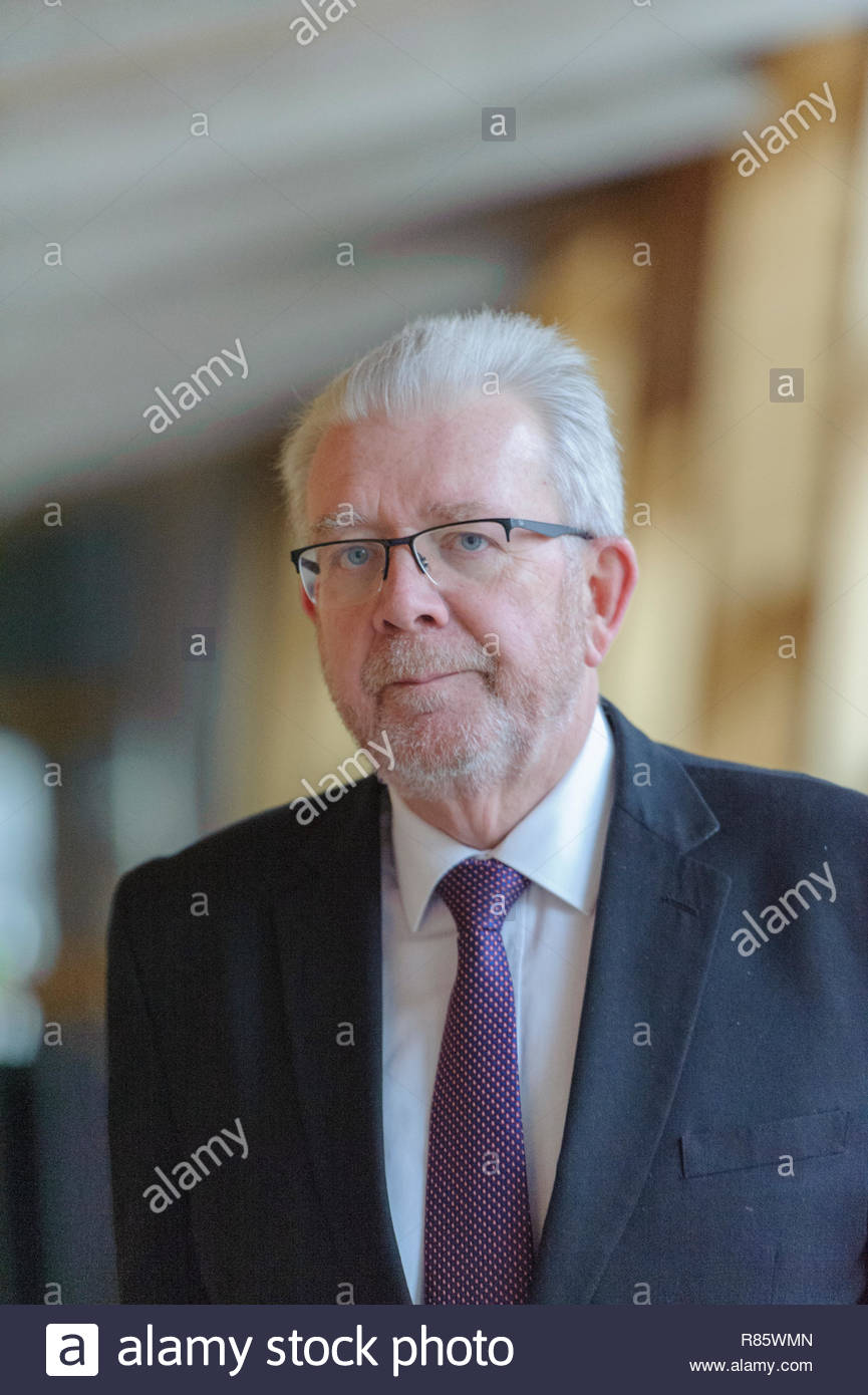 Edinburgh, UK. 13th December, 2018. Government Business and Constitutional Relations Secretary Michael Russell on the way to First Ministers Questions in the Scottish Parliament. Credit: Roger Gaisford/Alamy Live News - Stock Image