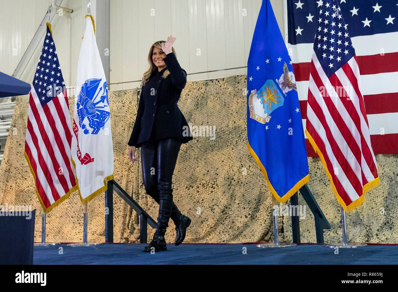 U.S. First Lady Melania Trump waves to service members and their families gathered in Hangar 789  during a holiday visit to Langley Air Force Base December 12, 2018 in Hampton, Virginia. - Stock Image