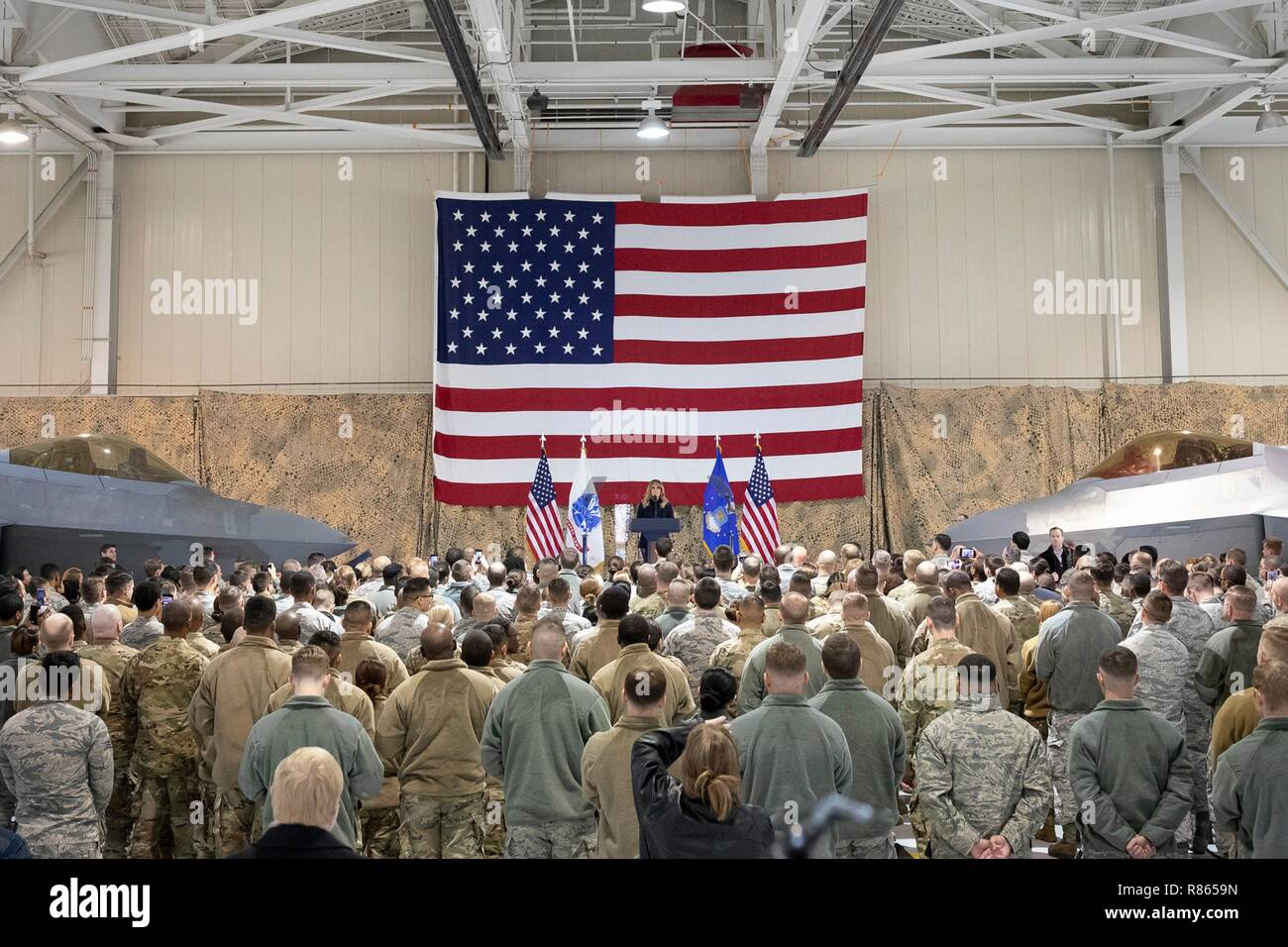 U.S. First Lady Melania Trump delivers remarks to service members and their families gathered in Hangar 789  during a holiday visit to Langley Air Force Base December 12, 2018 in Hampton, Virginia. - Stock Image