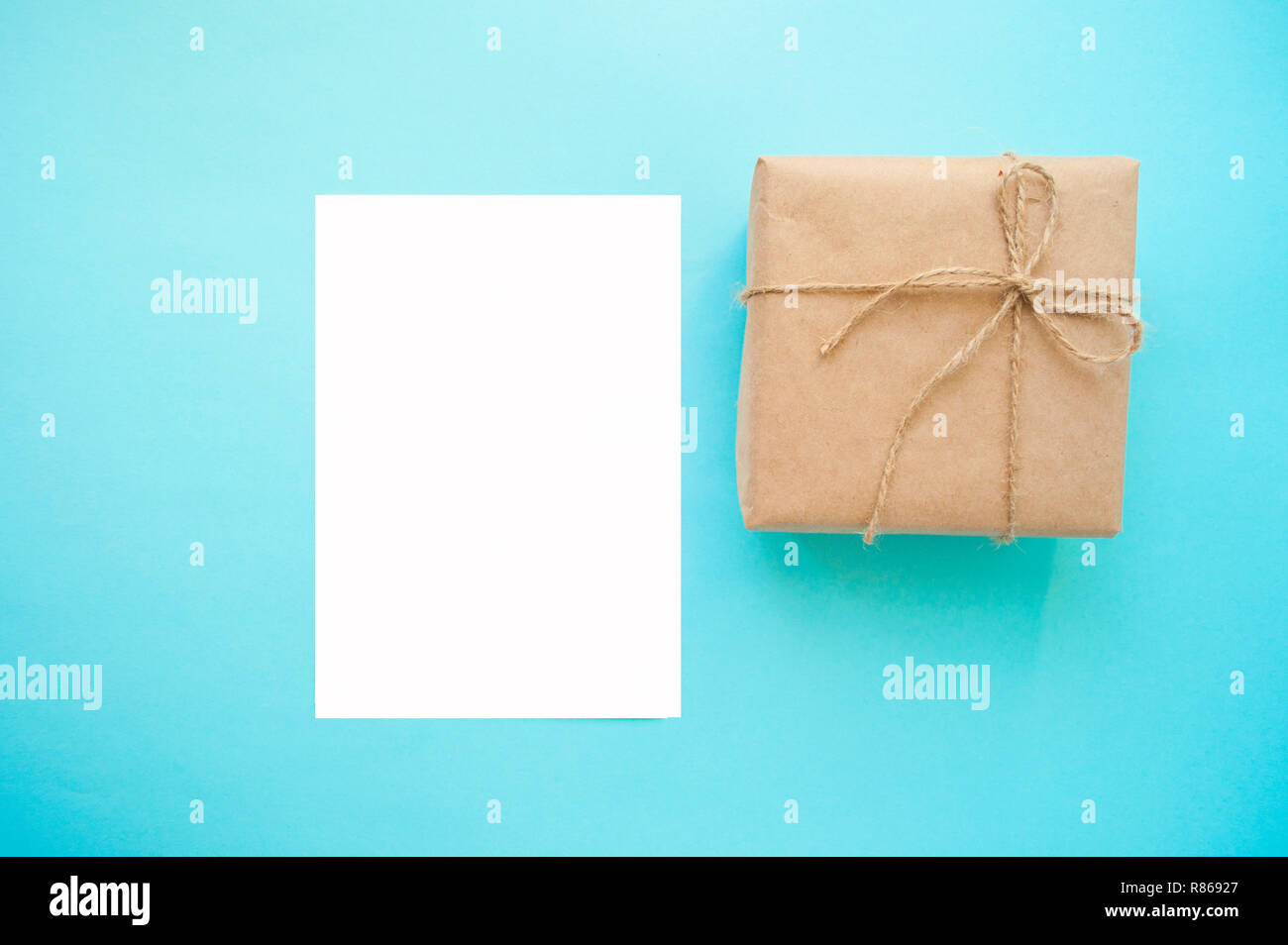 Gift Box Wrapped In Brown Colored Craft Paper And Tied With Cord On