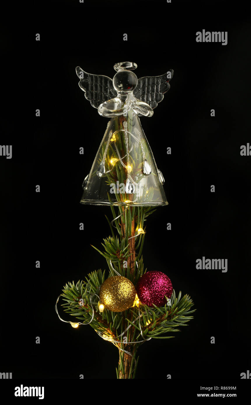 newest collection 95025 10ddc Glass angel, fairy lights and baubles on top of a Christmas ...