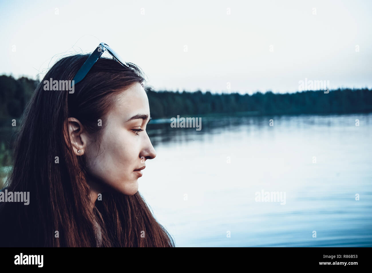 Female profile on the background of the lake. Vintage cool style. - Stock Image