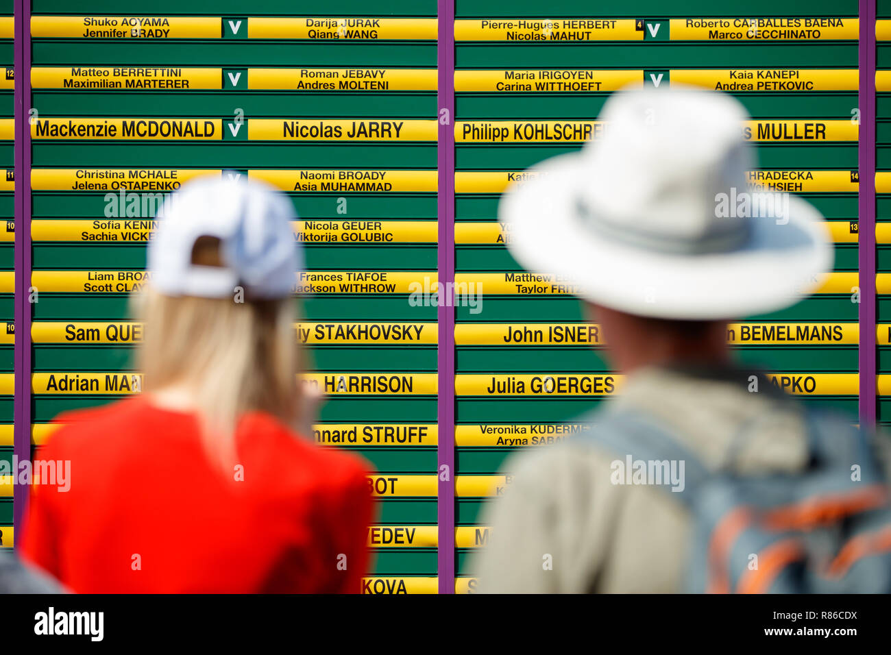 Color shot of fans looking at the draw and schedule boards during the Wimbledon Championships 2019 - Stock Image