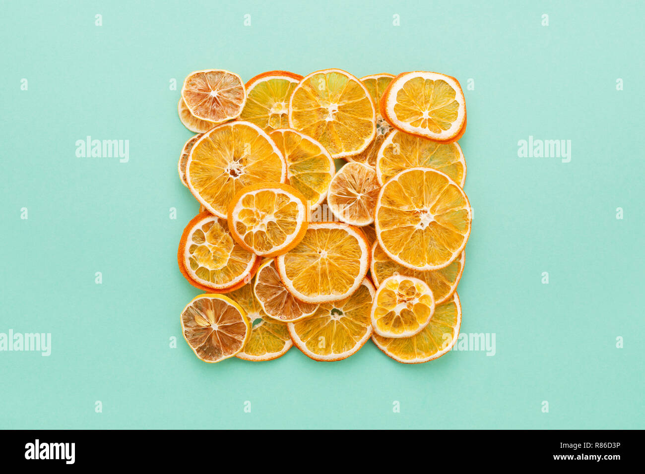 Dried Citrus Slices Lemons Oranges On Turquoise Colored Background
