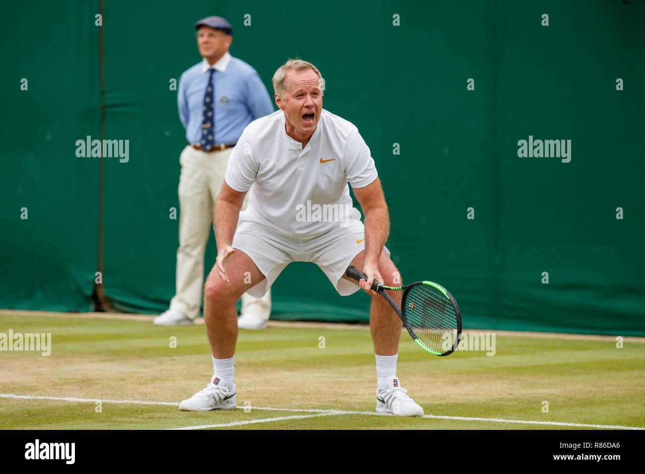 Tennis legend Patrick McEnroe during the Wimbledon Championships 2019 - Stock Image