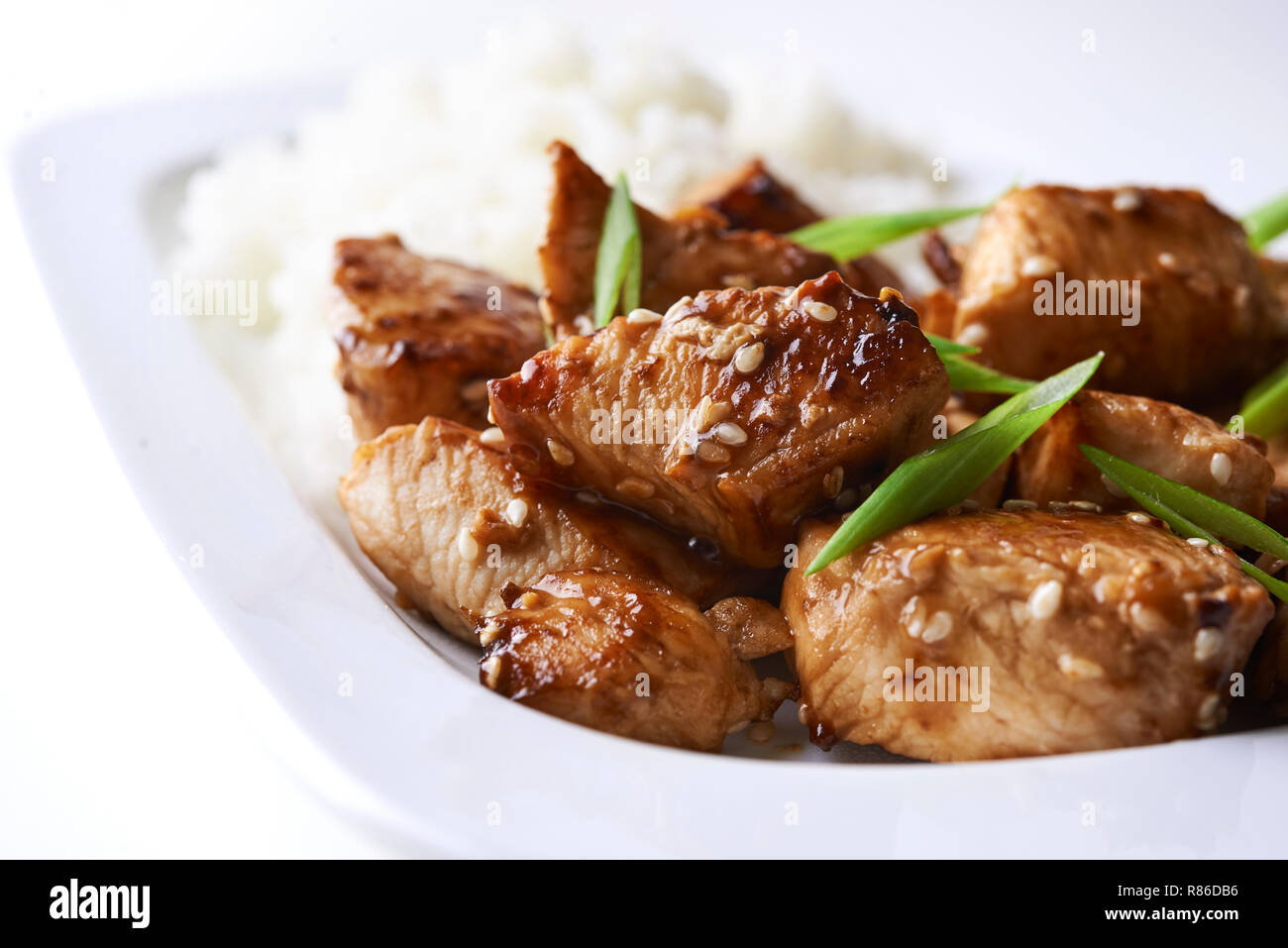 Plate Of Teriyaki Chicken And Rice Isolated On White