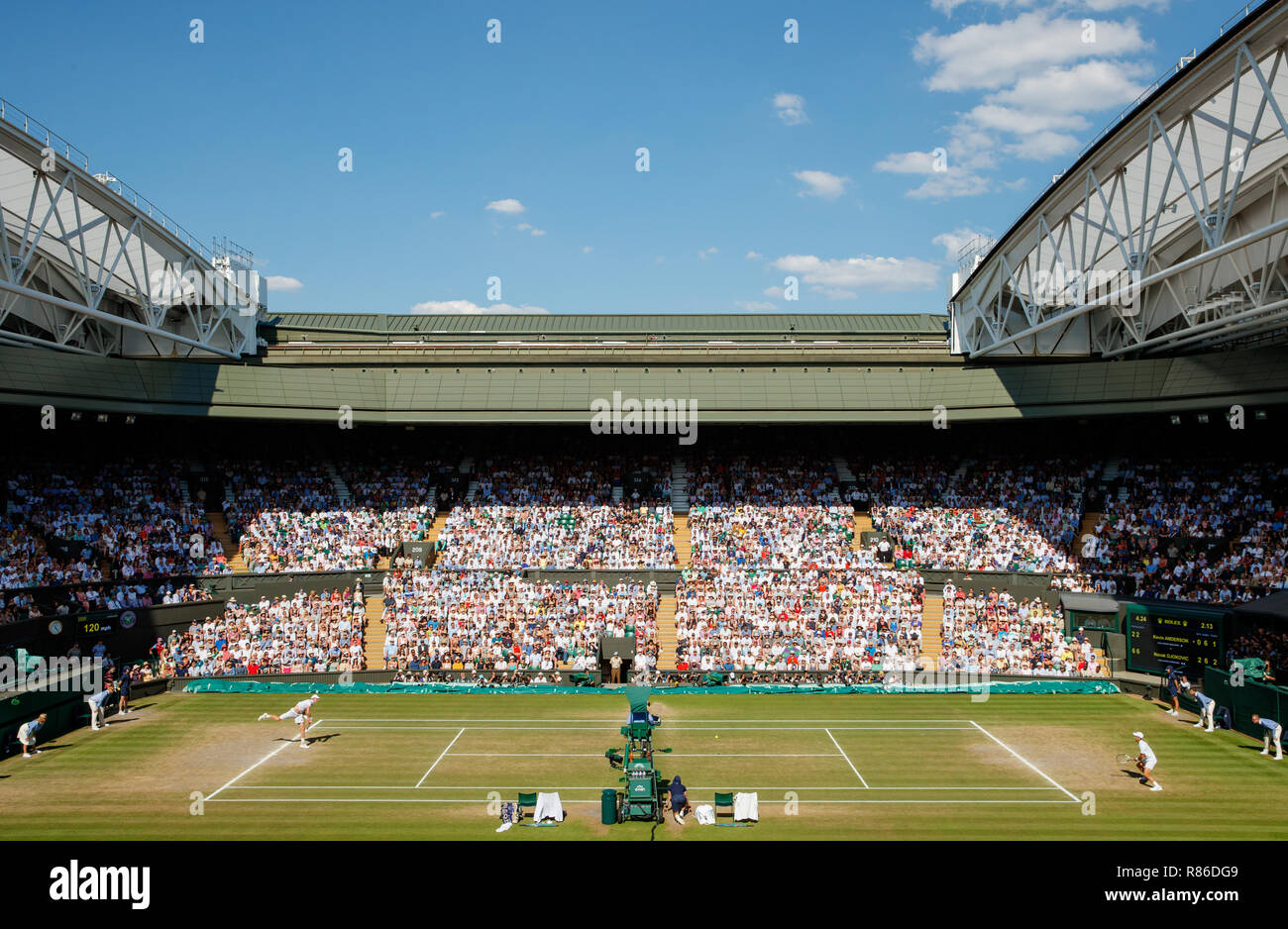 General wide view of Novak Djokovic of Serbia and Kevin Anderson of South Africa on Centre Court during the Wimbledon Championships 2019 - Stock Image
