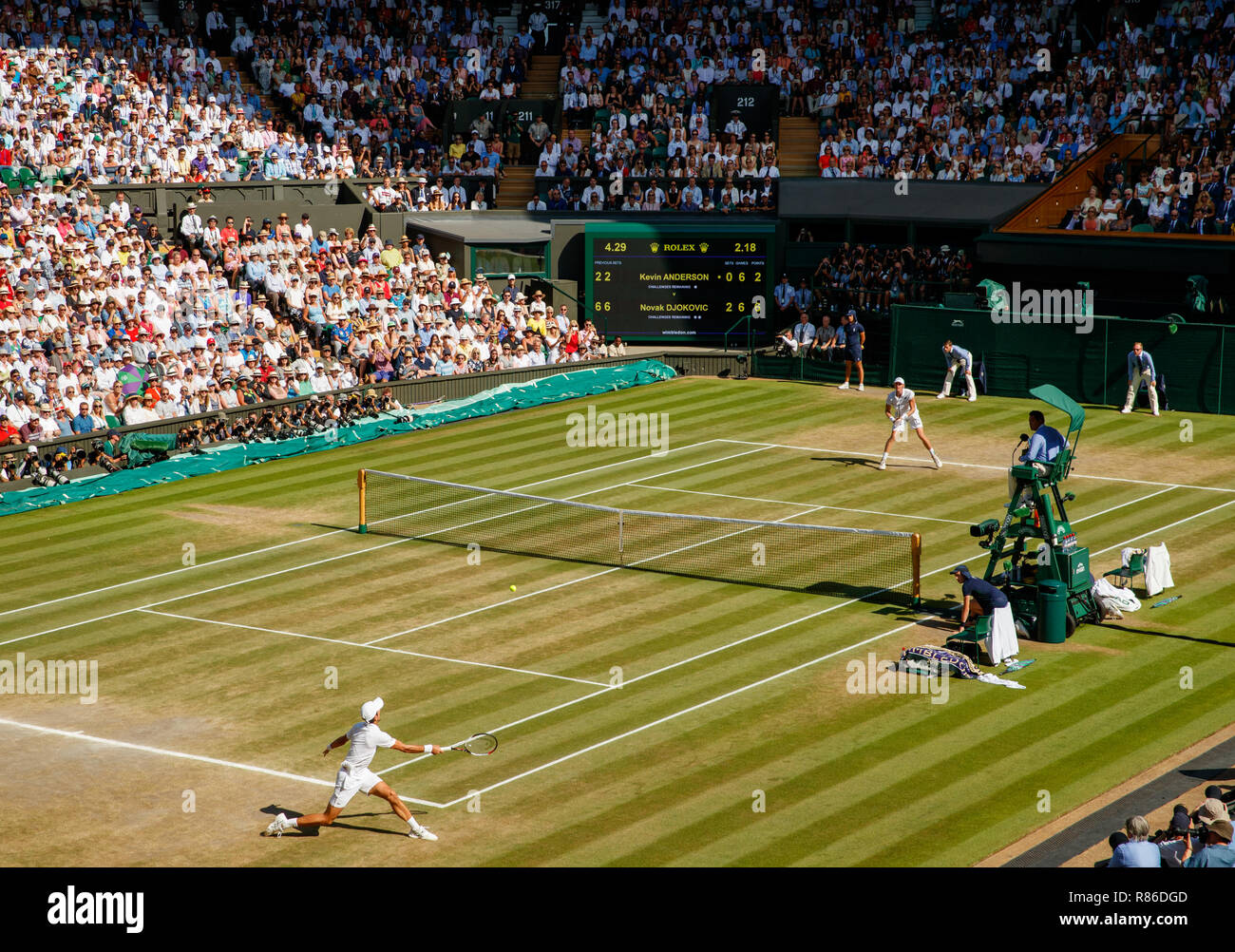 General wide view of Novak Djokovic of Serbia and Kevin Anderson of South Africa during the final of the Gentlemen's Singles during the Wimbledon Cham - Stock Image