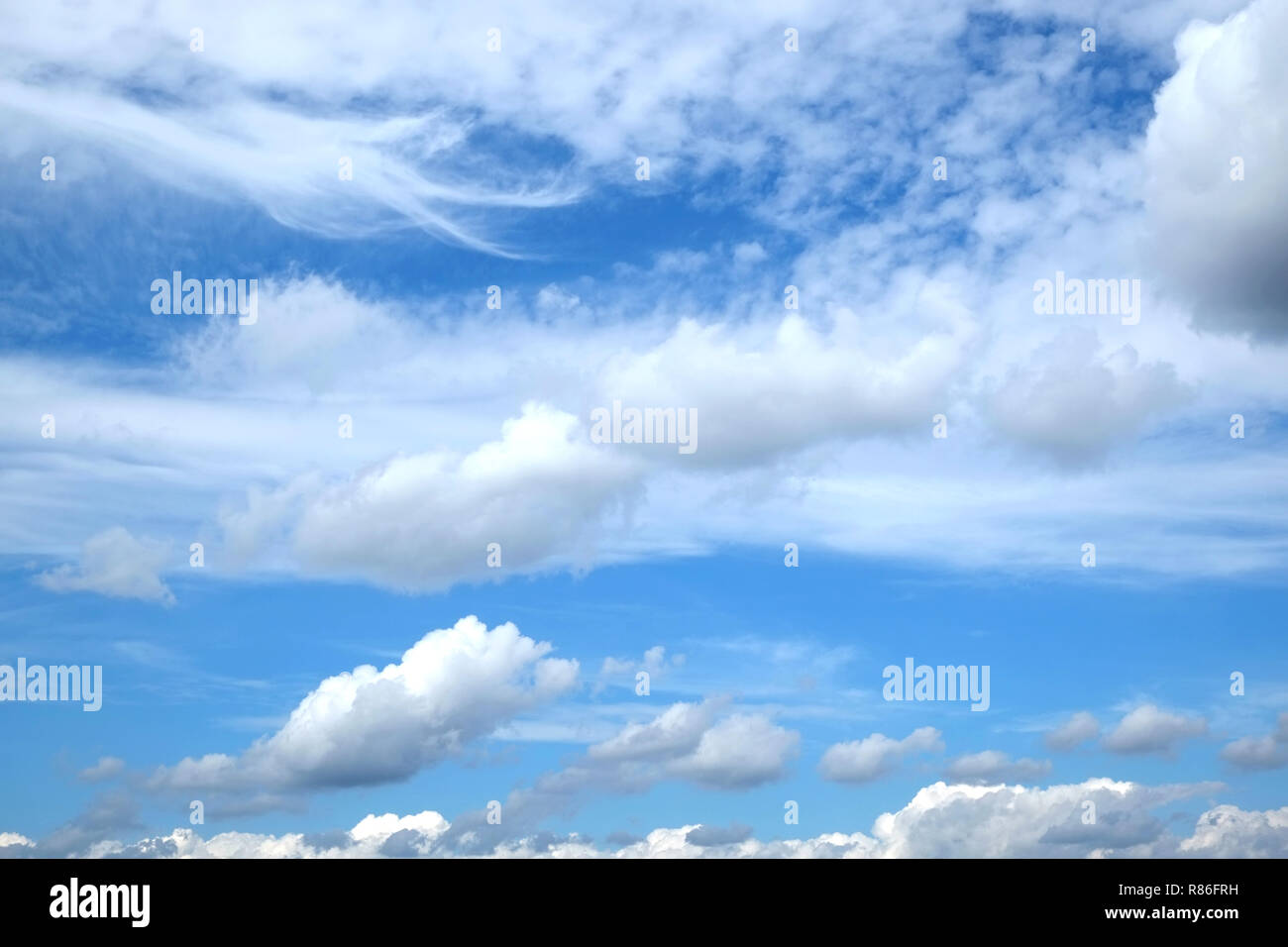 Beautiful sky landscape with white clouds high in the stratosphere on a sunny day horizontal photo - Stock Image